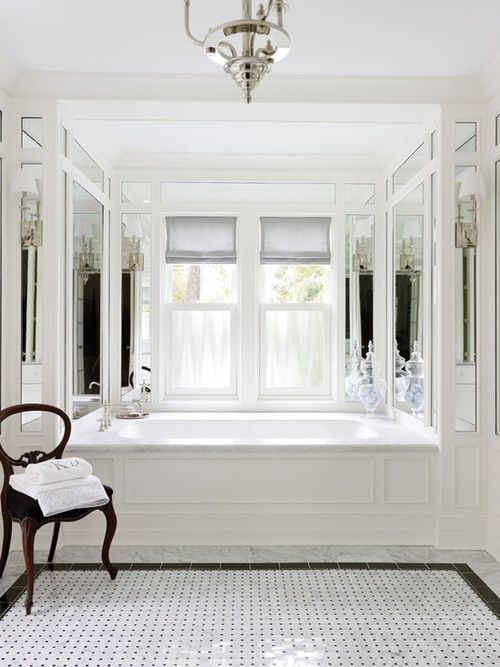Crisp, clean, and gorgeous vintage glamour in this master bath by Morgante Wilson Architects in Chicago.