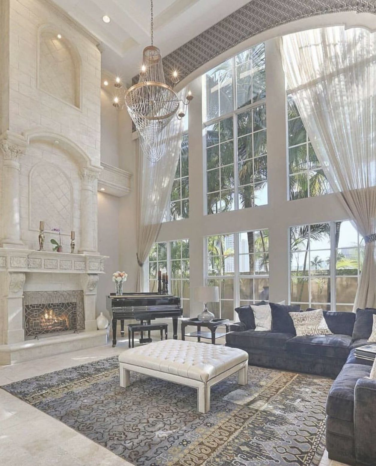 Elegant 2-story great room with wall of windows ...