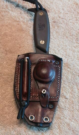 Leather front for my Hest, holds fire steel and compass.