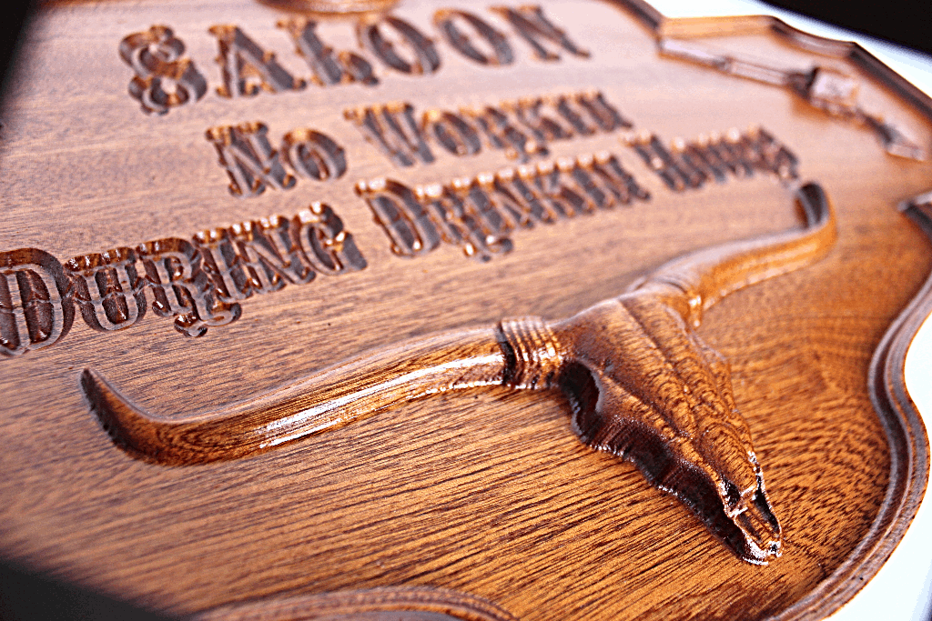 A 3D carved saloon sign for your favorite Man's man cave.