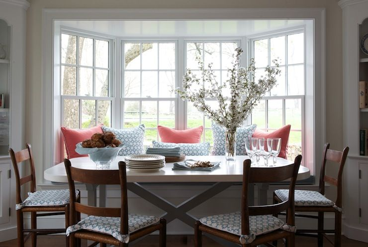Sweet Dining Room Featuring Built In Bench Filling Bay Window Accented With Coral And Blue