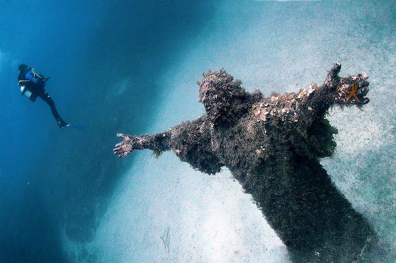 Christ of the Abyss - A submerged bronze statue of Jesus, created by Guido Galletti with the original located in the Mediterranean Sea on the Italian Riviera. In 1954 it was placed in the water near the spot where Dario Gonzatti, the first Italian to use SCUBA gear, died in 1947.  It depicts Christ offering a blessing of peace, with his head and hands raised skyward.