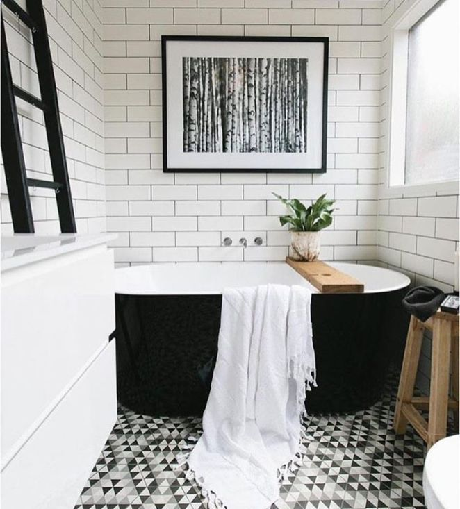 Idée décoration Salle de bain carrelage métro blanc baignoire îlot