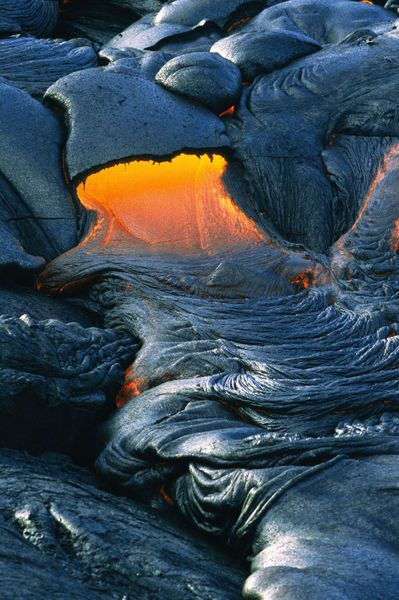 Hot pahoehoe lava flows from at Volcanoes National Park, The Big Island, Hawaii. #lava #hawaii