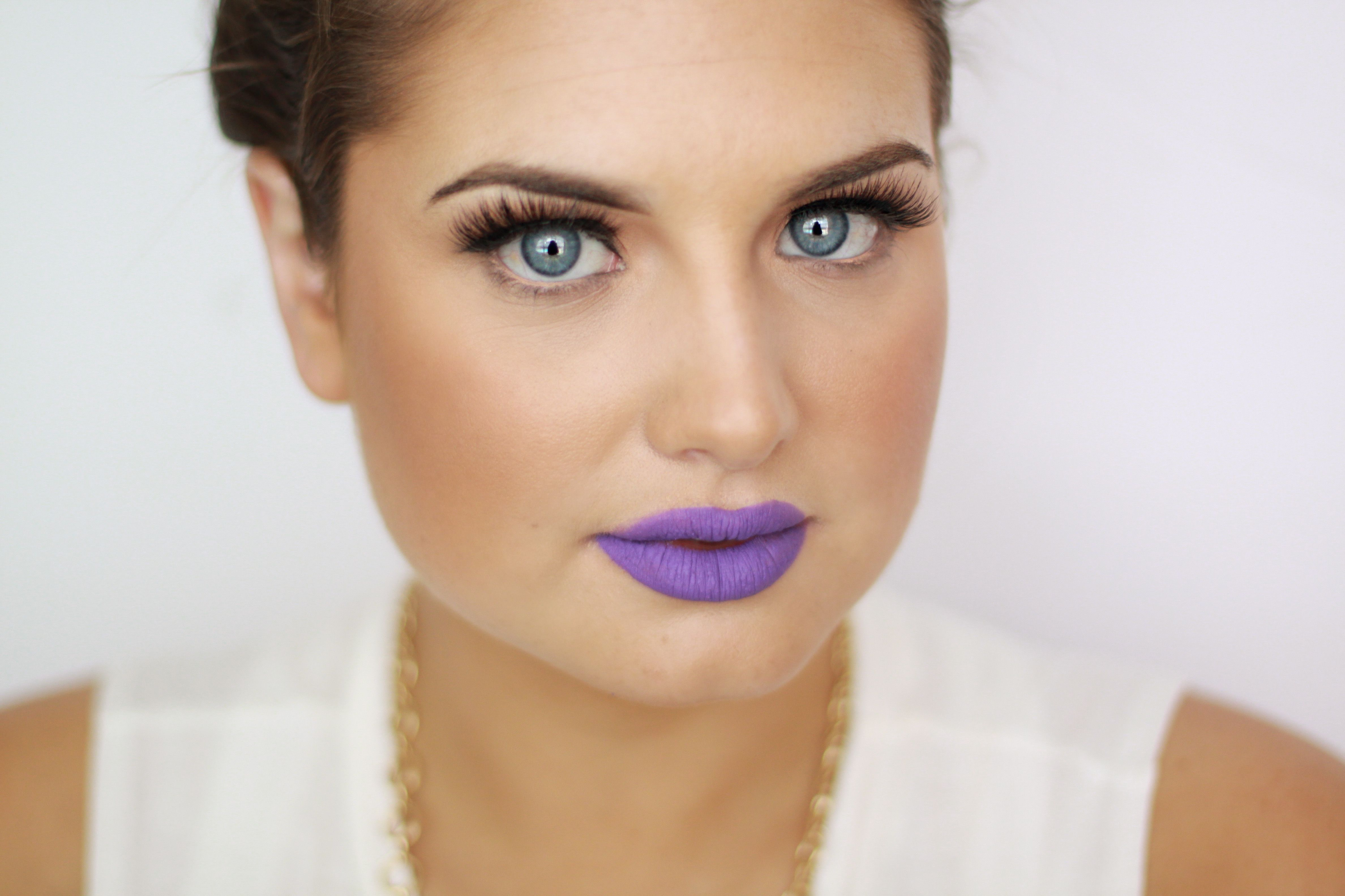 Funky makeup, purple lip, dose of colors liquid matte lipstick in Purple Rain, bold brows, lashes. Makeup by Sunkissed & Made Up