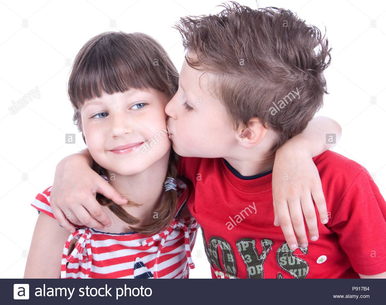 Download This Stock Image Cute Boy Kissing A Nice Girl Studio