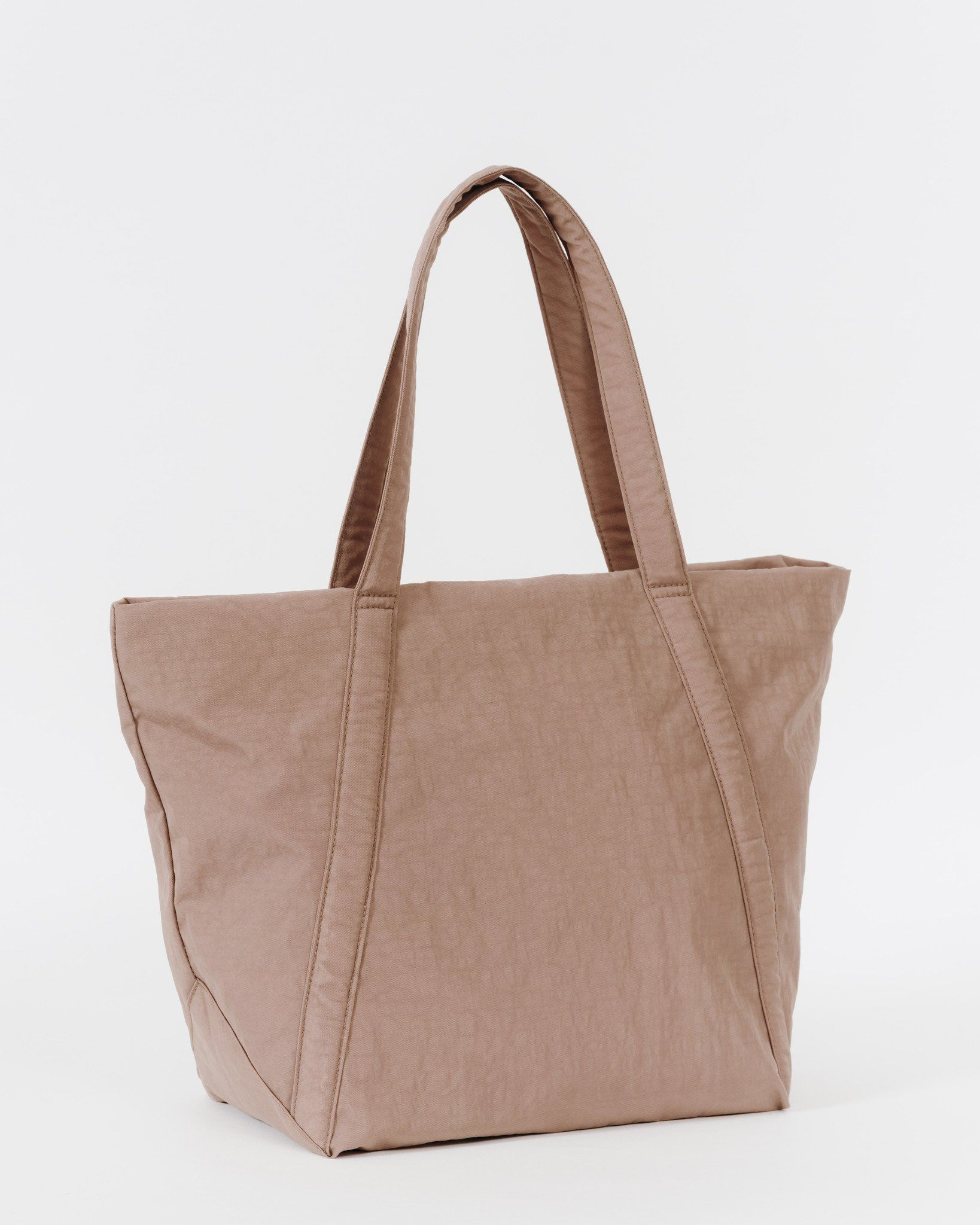 An easy bag for daily toting. Top zipper closure. Detachable interior zip pouch. Packs into its own pouch for easy storage. **** 12.8 in. W x 13.8 in. H x 8 in.