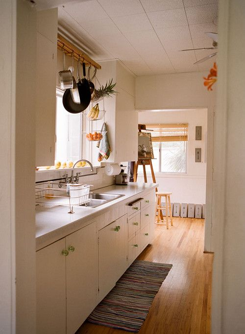 Pots and pans above sink