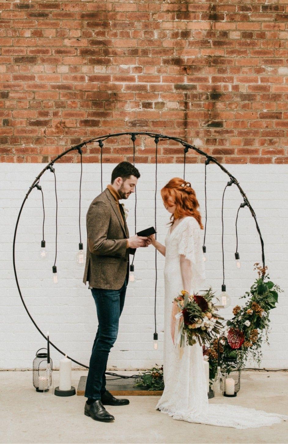 Earthy Tone Industrial Wedding At 92 Burton Road In Sheffield Edison Bulb Moongate Backdrop Wedding Industrial Wedding Edison Bulb Wedding Boho Flower Girl