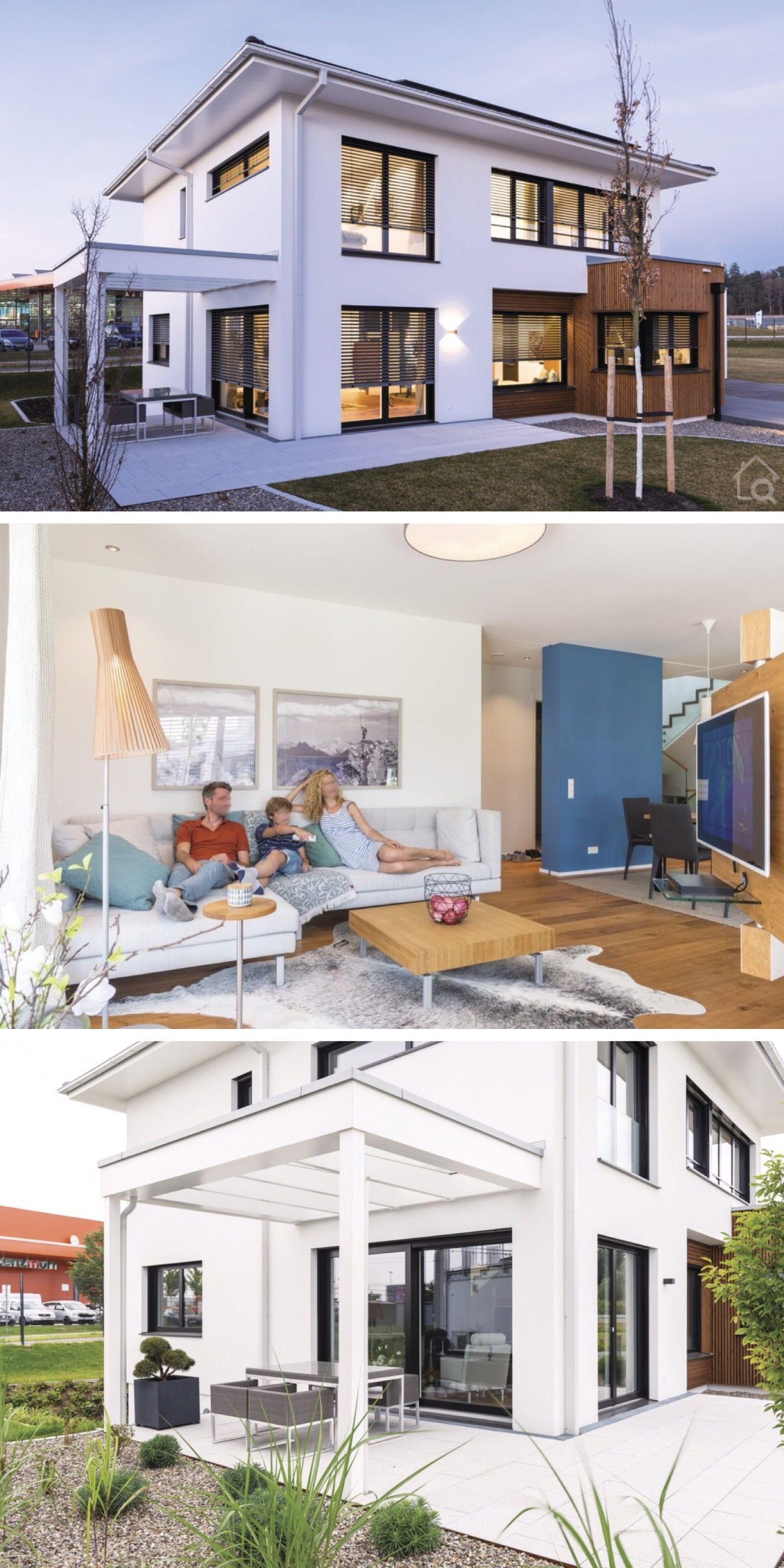 Stadtvilla modern mit Garage, Walmdach & Putz Fassade weiß