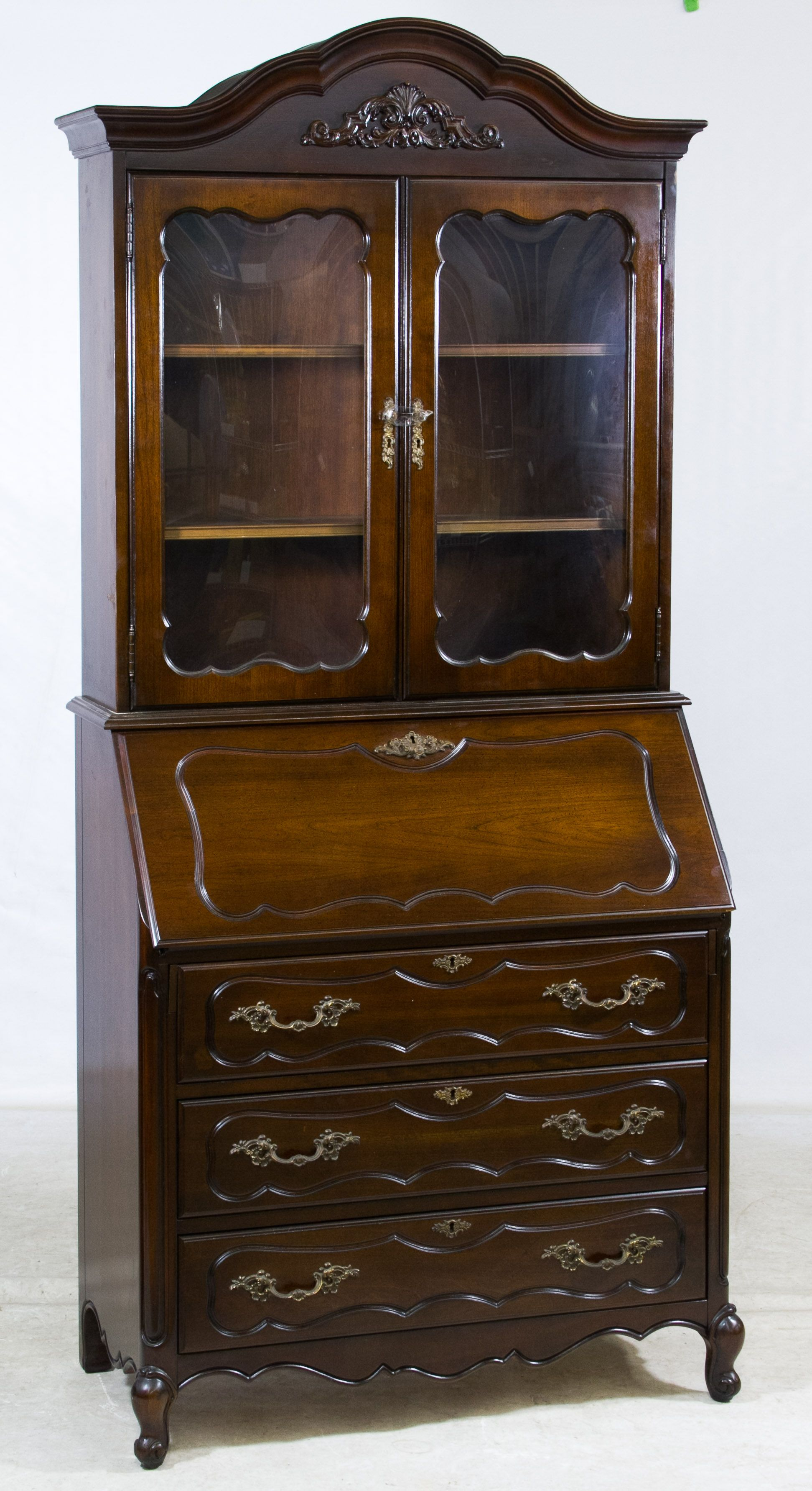 Lot 112 Walnut Stained Secretary by Jasper Having two wood framed