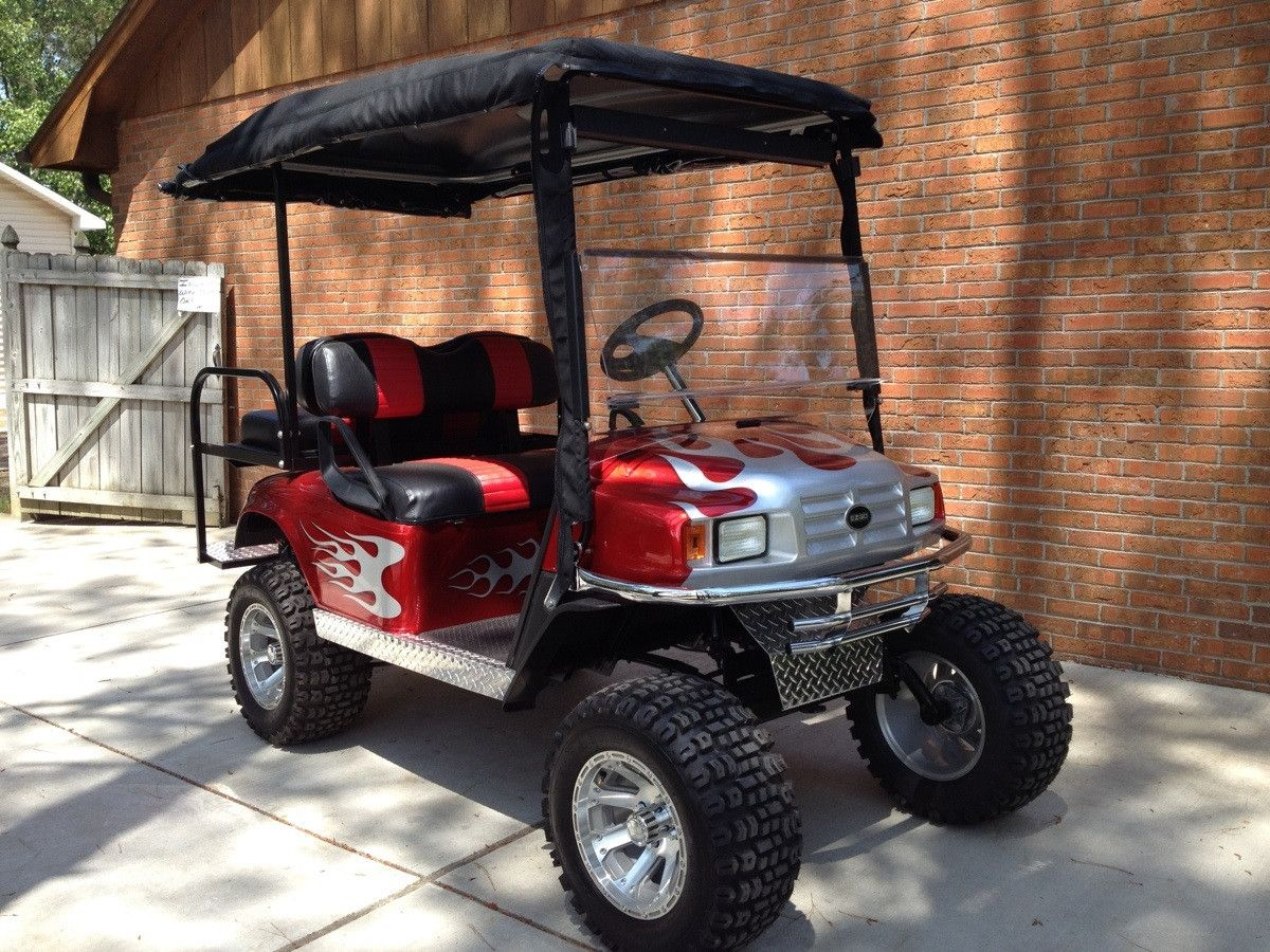 This is a custom golf cart I built to be used to haul Robert Downey Red Lifted Golf Cart Burgandy on red ezgo golf cart, red dot enclosures golf cart, lifted ezgo golf cart, car wheels on lifted golf cart, red custom golf cart, red chevy golf cart, super lifted golf cart, red golf cart illustration, lifted yamaha golf cart, red jack up golf carts,