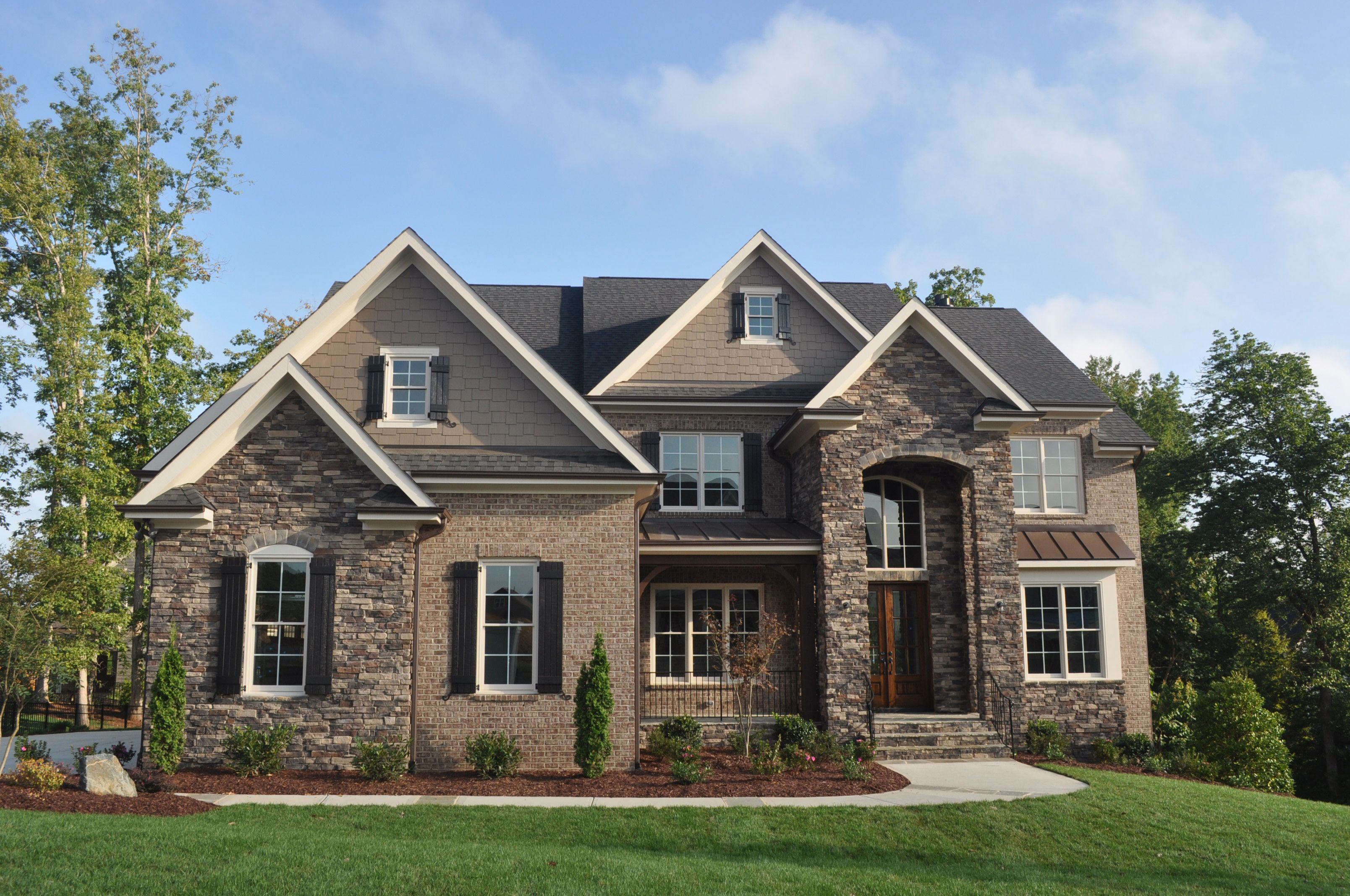 exterior with stone, brick, and siding. use hardiplank instead of