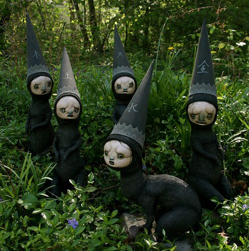 Giggleweird gnomes - Just the pic - I would imagine a bunch of these hiding in your shrubs would looks pretty creepy at night.  Especially if you use glow in the dark paint on their faces.