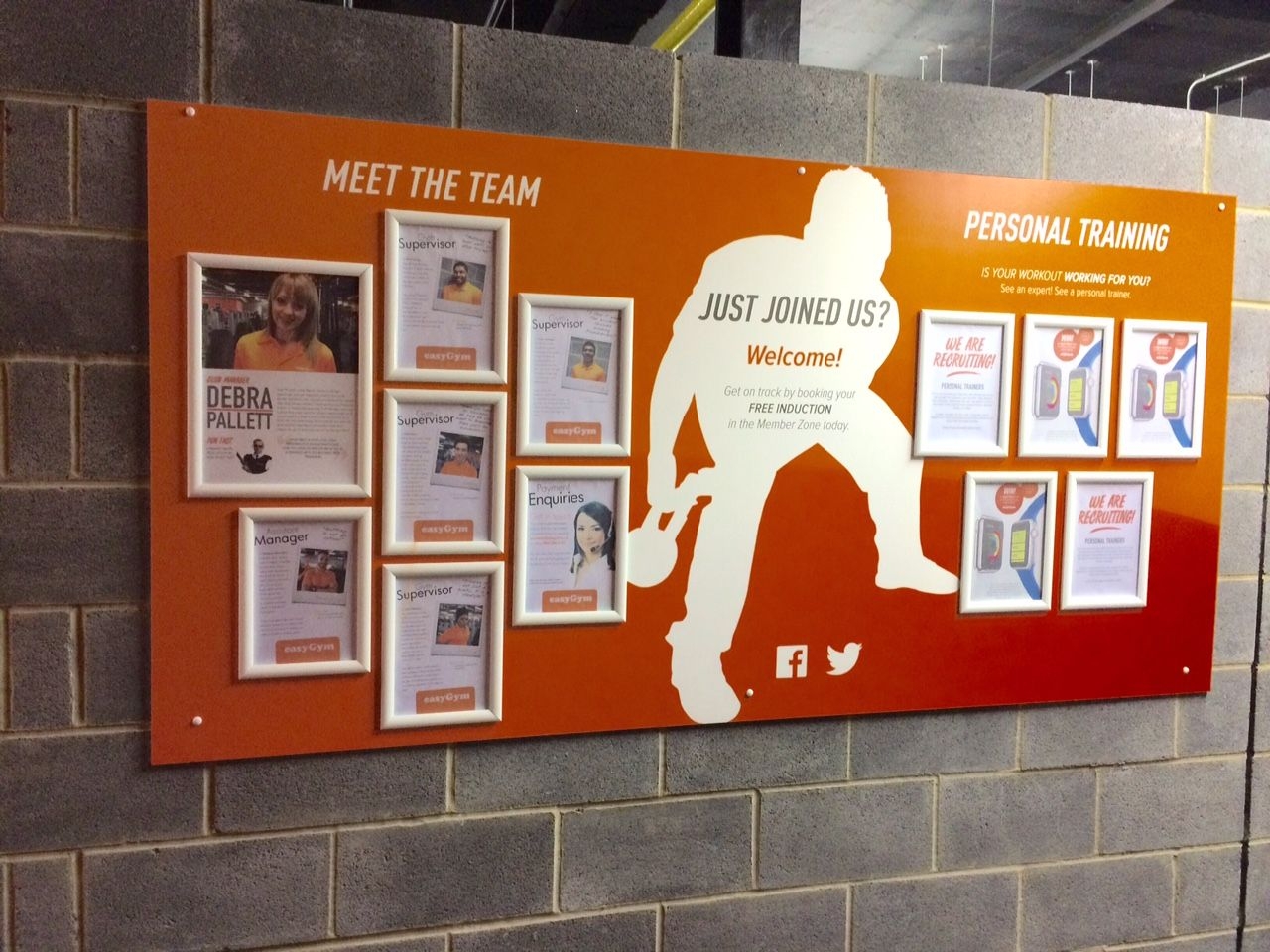 Bespoke, modern noticeboard for EasyGym with snap frames
