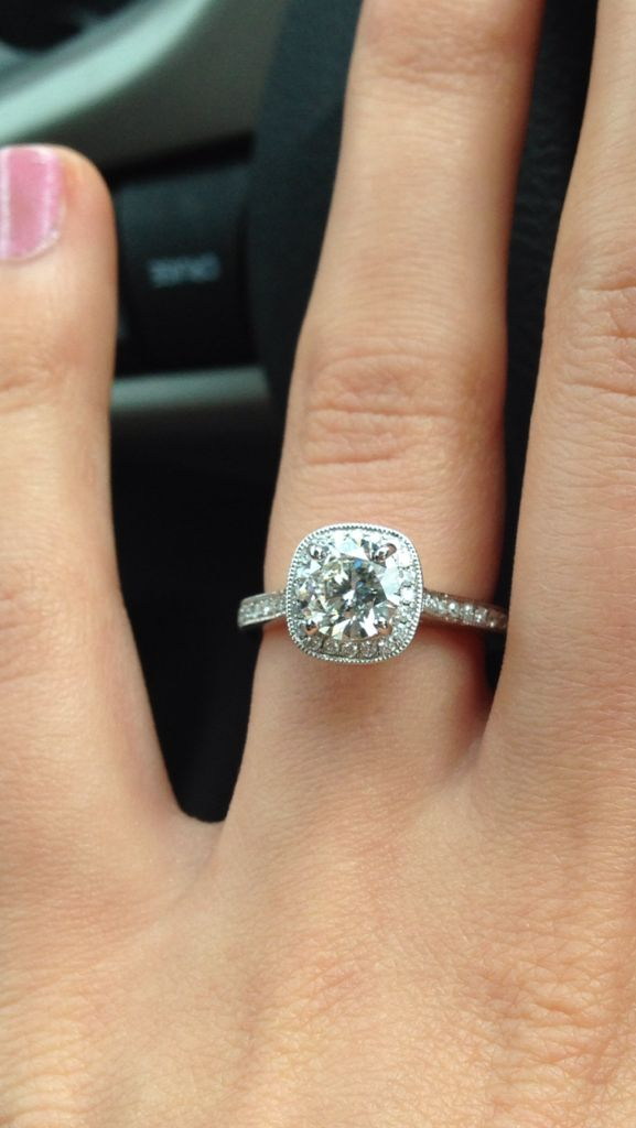 round center stone with a cushion cut halo