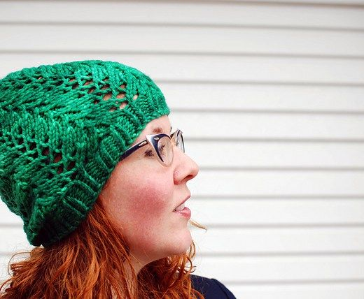 Hibiscus is a chunky lace beanie hat from Clare Devine's Tea Collection. The pattern includes variations for different amounts of slouch and 3 sizes to choose from. Available as an interactive pattern to use with the Knitmastery app. #knitmastery #claredevine #teacollection #knitsharelove #chunky #hat #lace #beanie