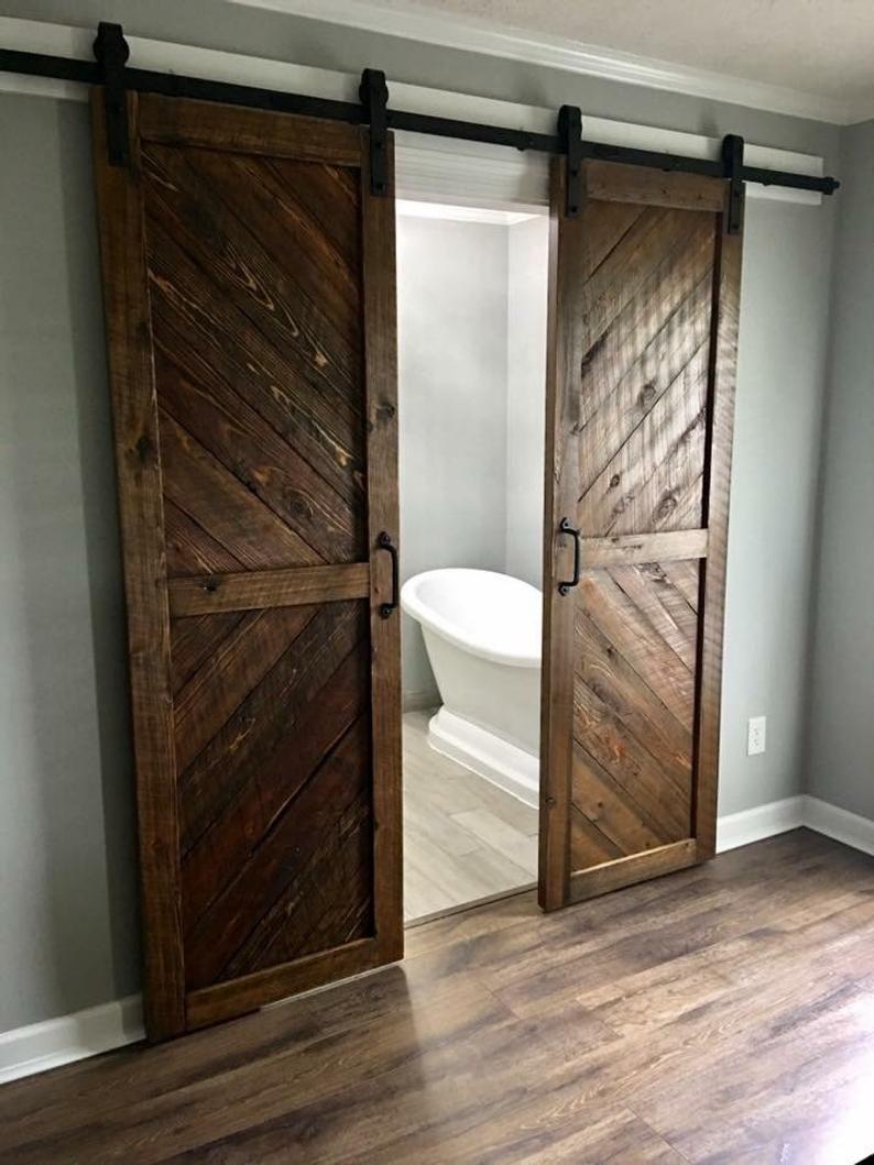 Solid Cypress Sliding Chevron Barn Doors Built To Order In 2020 Barn Door Custom Barn Doors Interior Barn Doors