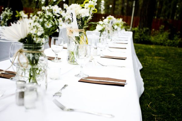 Weekend Mountain Wedding: Mrs. Espresso's Details: Long tables with mason jar floral centerpieces