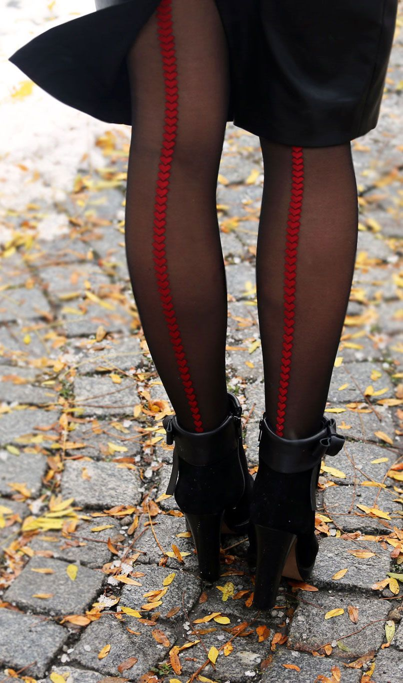 8162f1c1b39 Pop of red in an all-black outfit