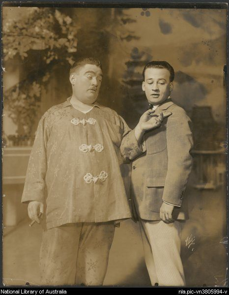 Man in oriental pyjamas holding a cigar and young man in the J.C.  Williamson New York production of Canary cottage 5dfb3afb5