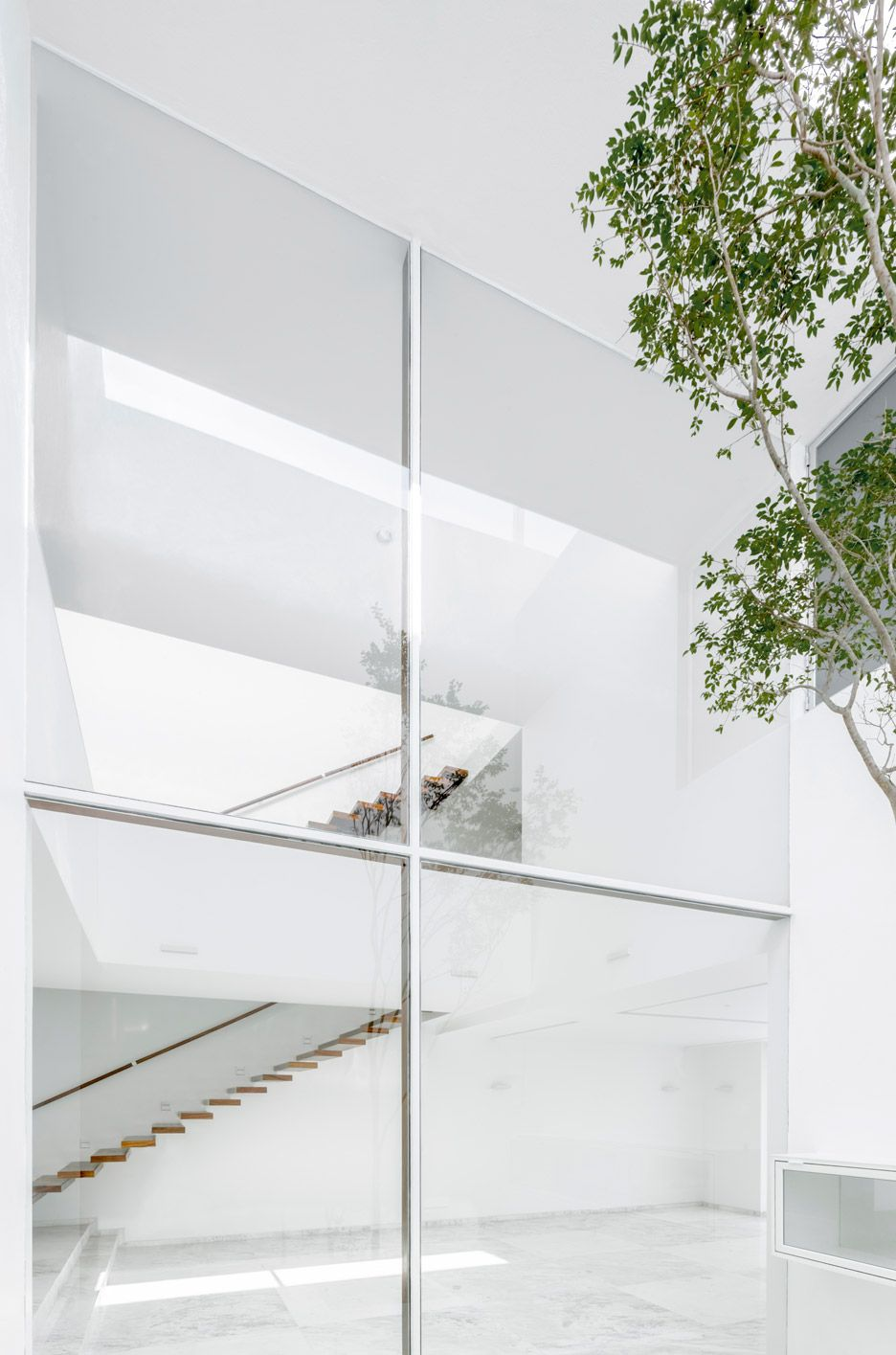 Cross-shaped frame supports double-height window in V House   Window ...