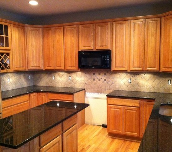 Tile Backsplash Granite Countertop Oak Colored Cupboards Light Cabinets With Products Kitchen