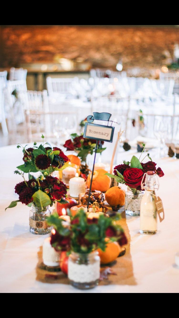 October gardening autumn harvest country wedding homemade burgundy England. Red roses. Centre piece. Hessian table runner. Top table. Homemade home grown.