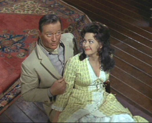 When his wife comes out of her bedroom to see what's going on McLintock asks her if she's going to believe what she sees or what he tells her.