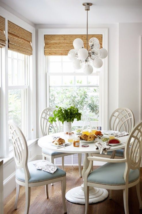Elegant Corner Breakfast Nook Features White Glass Cluster Pendant