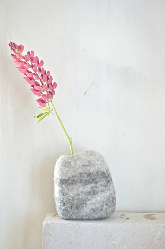 Art felt wool rock with test tube flower vase. It is modern accessory in home decor. Felted stone vase is exclusive interior detail.  This unique felt natural wool vase with glass test tube is made by hand. I make vases in shape and look as natural stone, but it is soft, unbreakable and light weight, but perfect standing on all surfaces vase.  With this flower vase you will bring a peace of nature to your home.  SIZE approximately : Felt stone: 13 cm length, 9 cm width, 17 cm height cm (5.12…