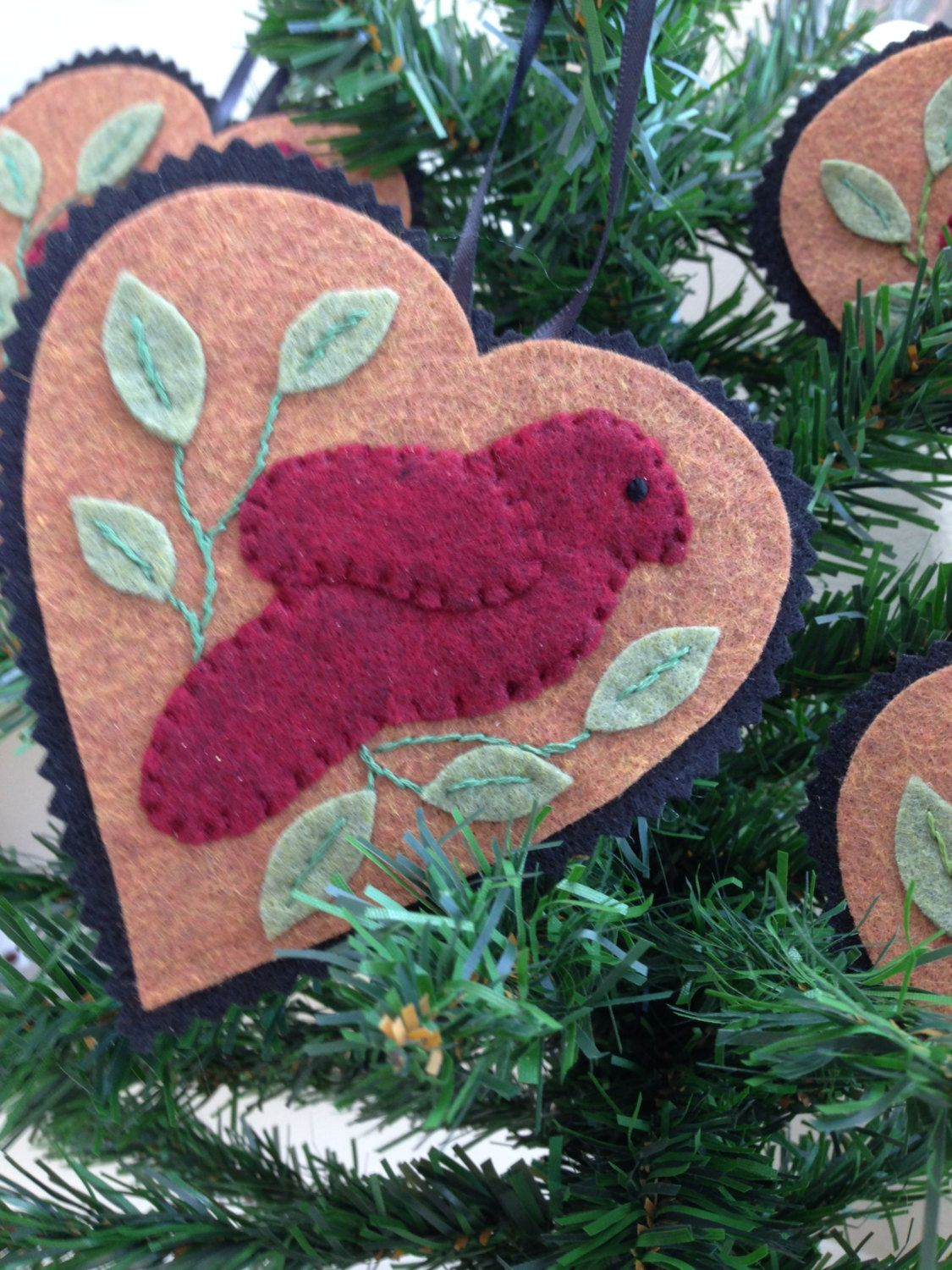 Embroidered christmas ornaments - Heart Shaped Hand Embroidered Fork Art Christmas Ornament With Bird Primitive