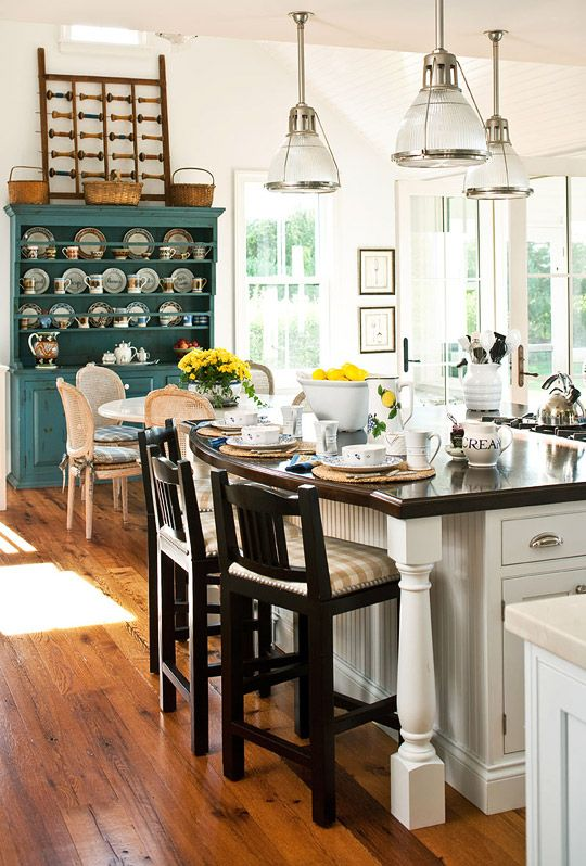 Love this kitchen and the painted hutch that houses the homeowner's collection of mochaware.
