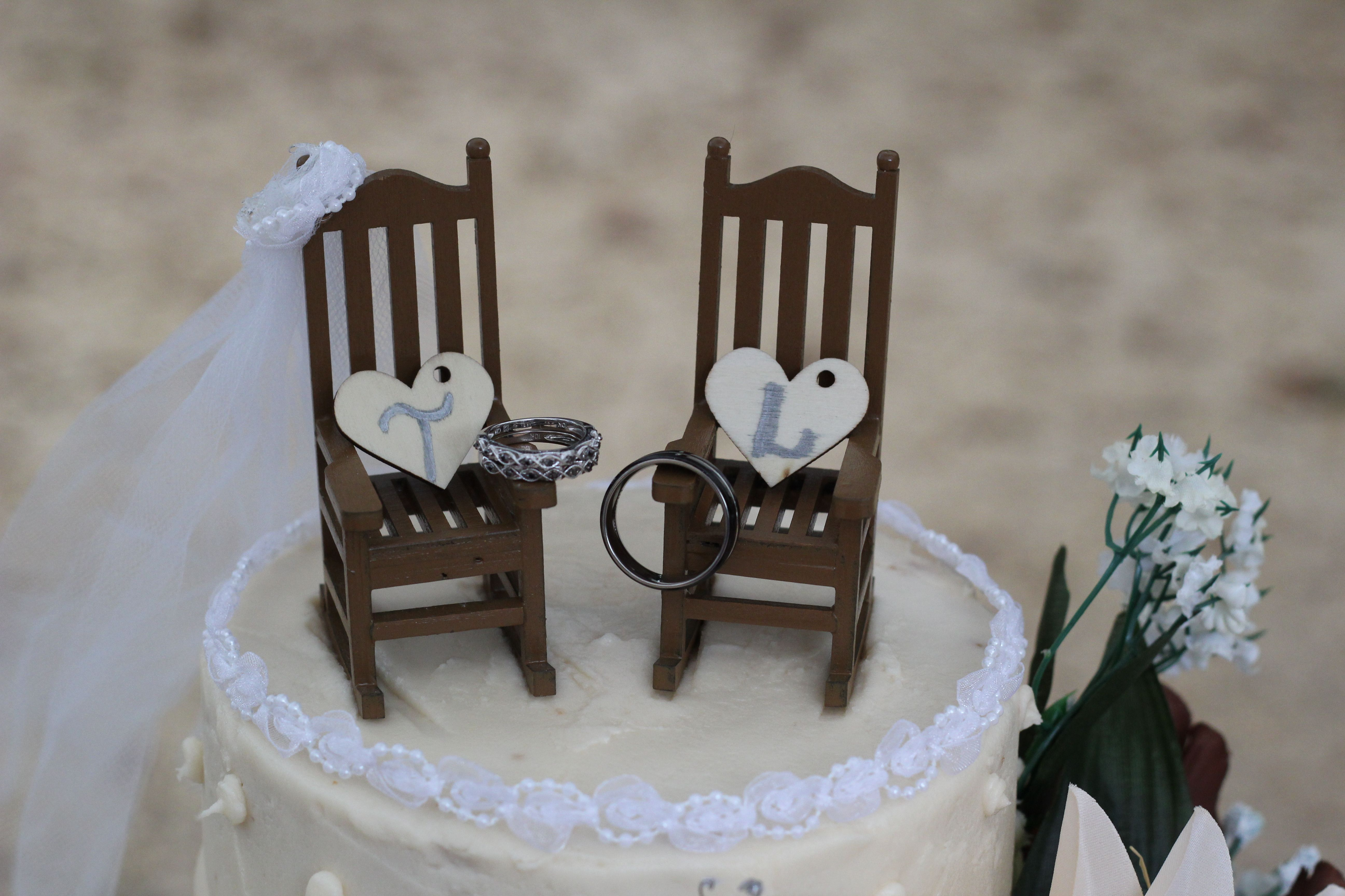 Find This Pin And More On A Rustic Wedding At The Neshoba County FairGrounds Pavilion Rocking Chairs As Cake Topper