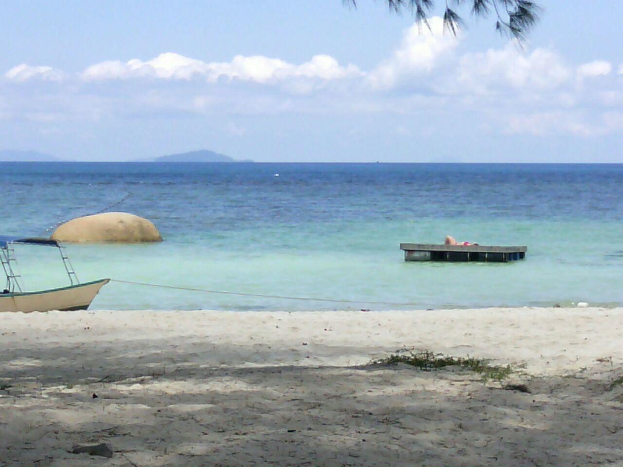 Sunbath on pontoon. #WatercoloursResort #Pulau #Perhentian #Beautiful #Beach #Island #Resort #Travel #Vacation #Tours #Professional #Dive #Centre #Malaysia #Snorkeling #Corals #Fish #MarineLife #PADI #ScubaDive #DiveTrip #BoatDive #EcoConservation #Holiday #Family #TeamBuilding #Chalets #Impressedus #Hospitality #discovery