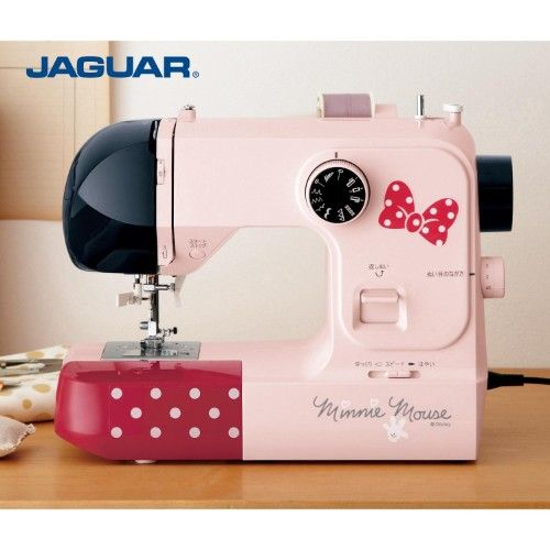 Large table with electronic sewing machine (Minnie Mouse)