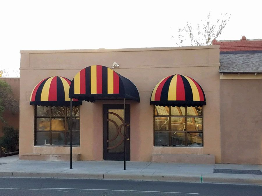 Two Domed Awnings And An Arched Entry Awning In The Colors Of The Belgian Flag For A Belgian Restaurant Awning Custom Awnings Residential Awnings