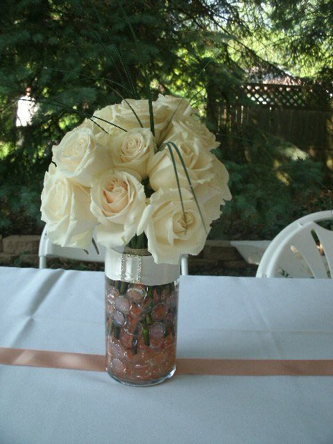 Fresh White Rose Arrangement In Cylinder Vase Of Water And Flesh And