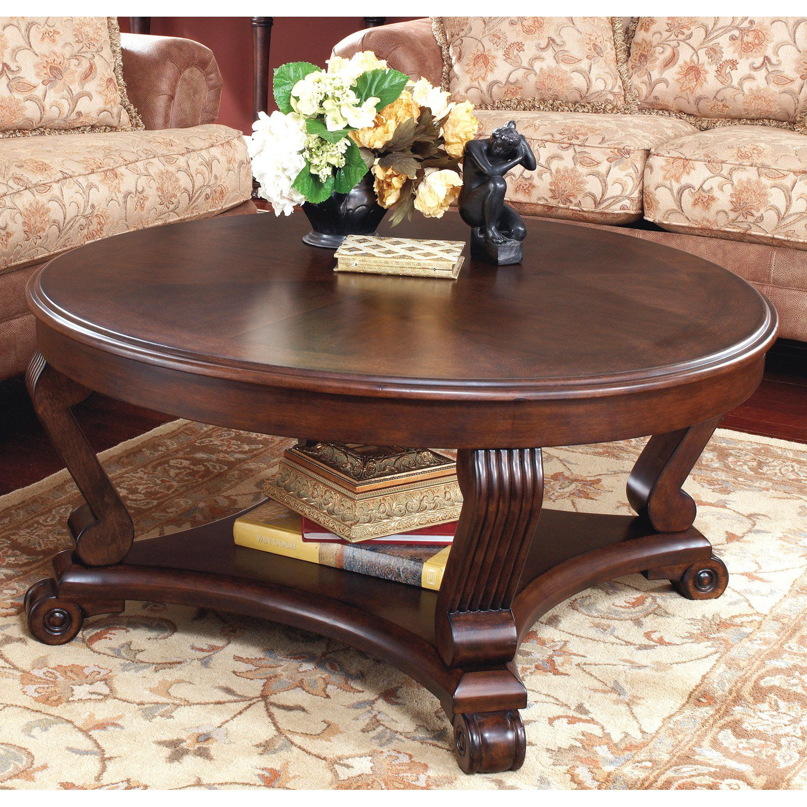 258 signature design by ashley brookfield brown 42 round 258 signature design by ashley brookfield brown 42 round cocktail table from hayneedle geotapseo Image collections