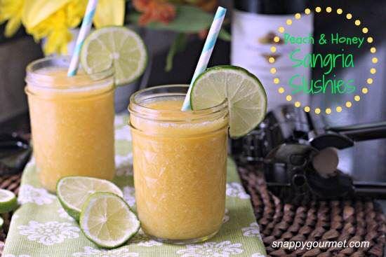 Peach & Honey Sangria Slushies, frozen cocktail recipe with white wine, orange liqueur, peach liqueur, fruit juice, honey and peaches. Best summer drink!