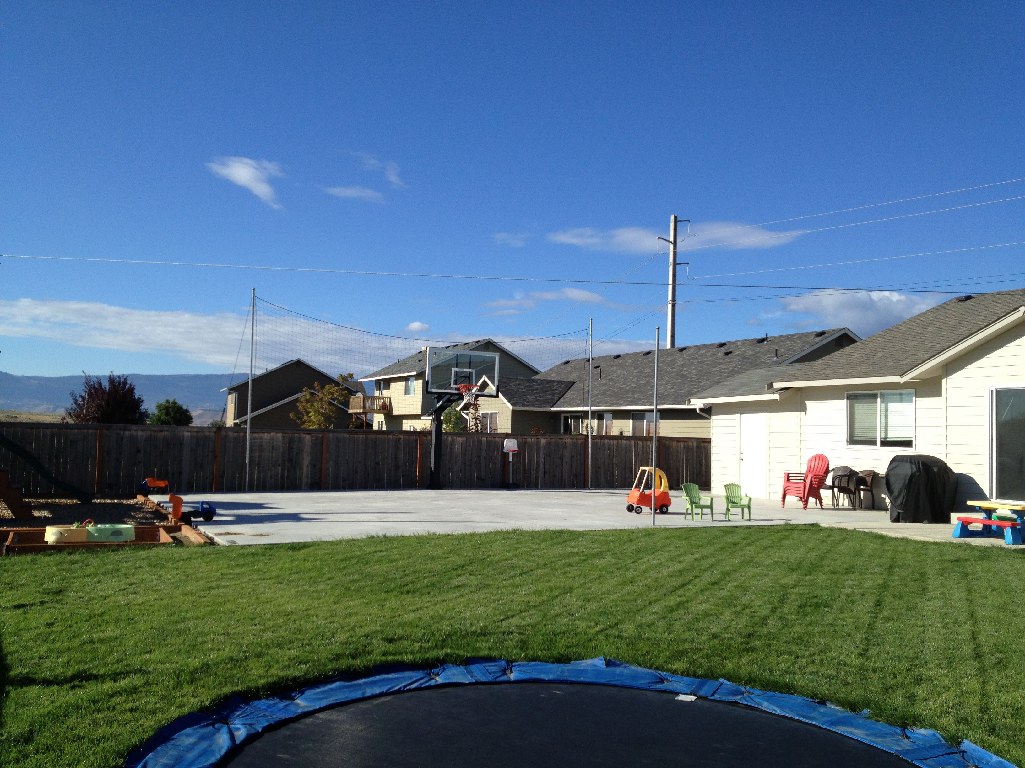 there is another wide view of their backyard pro dunk hoops