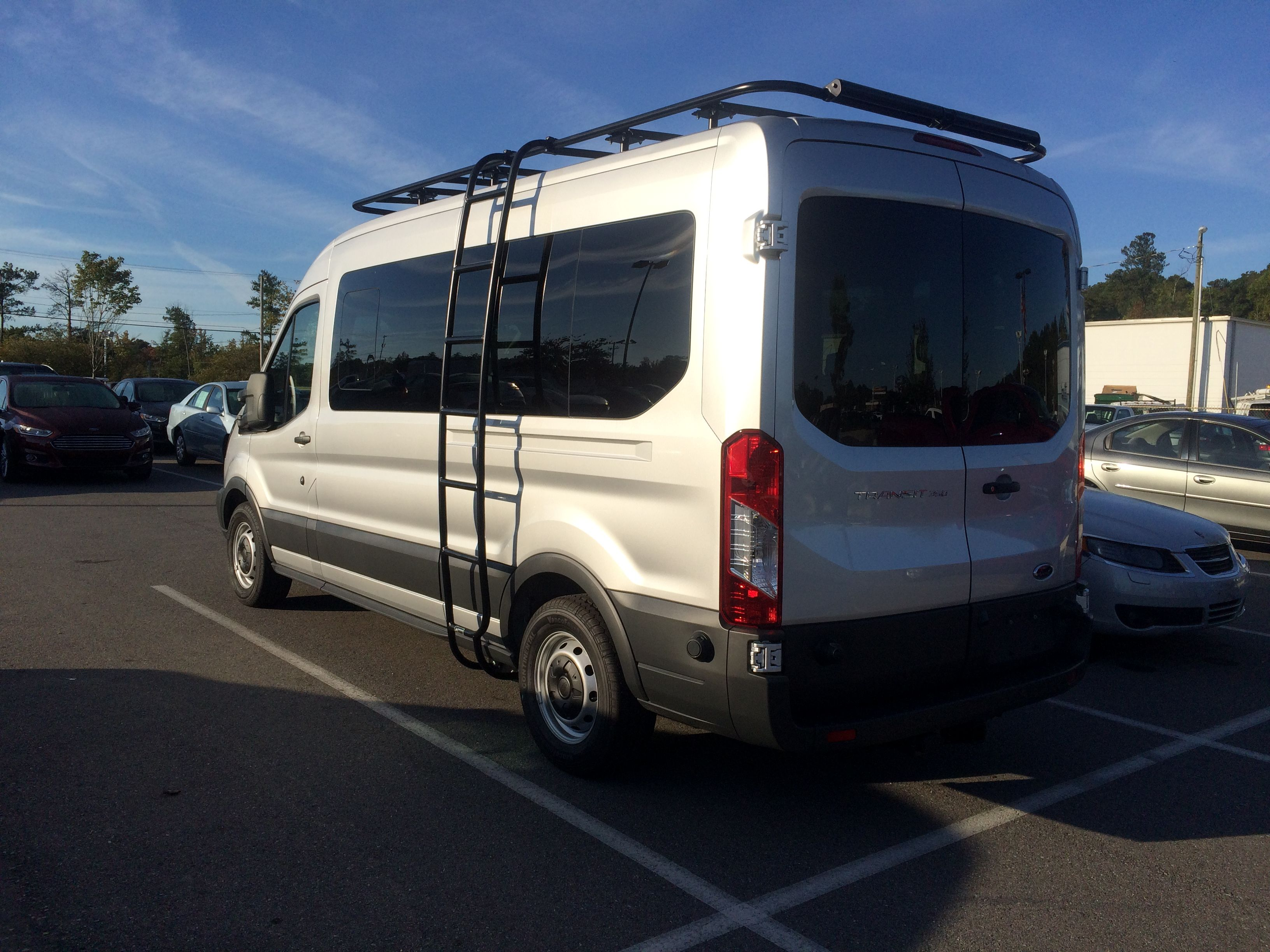 Customer pic from tindol ford aluminess roof rack and ladder installed on a new ford transit