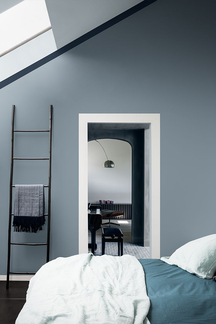 the warm grey tones of denim drift will make any bedroom more inviting after a long days work