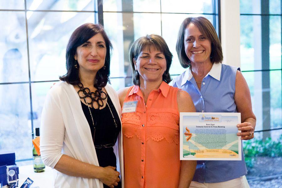 Co-founders acknowledge Karen Dippel (Creative Edge Marketing) with certificate of merit