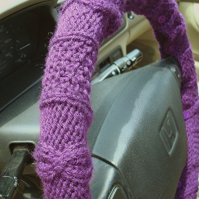 Here's a practical project...or at least fun! Knit a steering wheel cover!