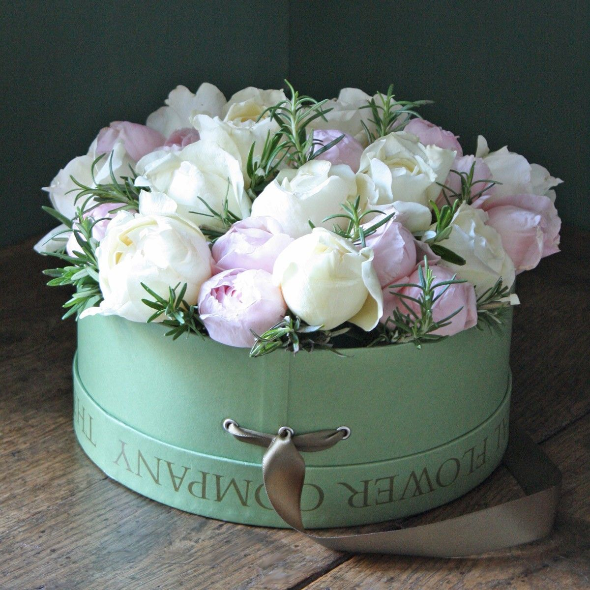 Hat box arrangement filled with pink and ivory roses and rosemary gardens izmirmasajfo Image collections