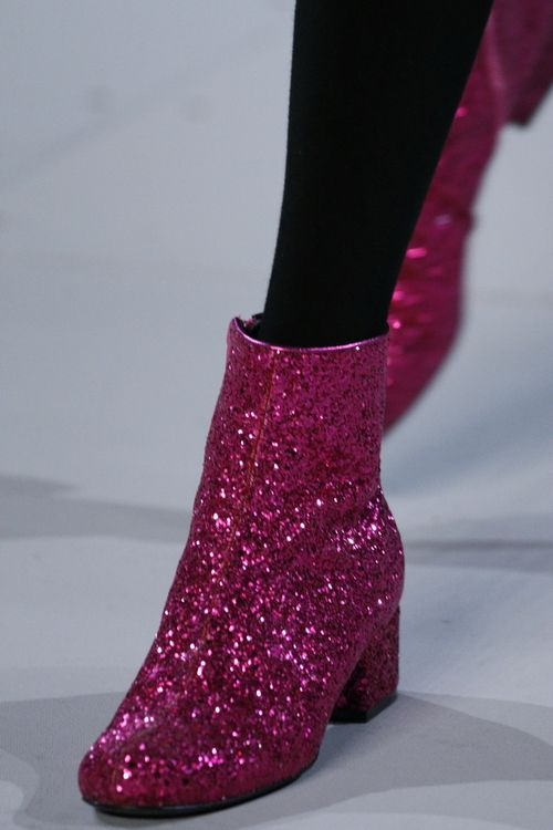 We love anything sparkly, especially these glittering pink boots from #SaintLaurentParis #AW14 #PFW
