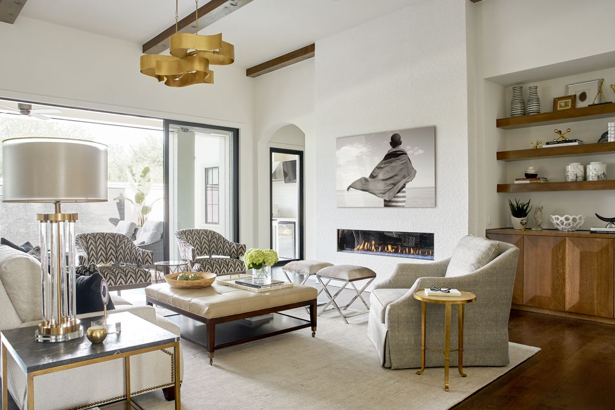 A polished yet sophisticated contemporary living room featuring a ...