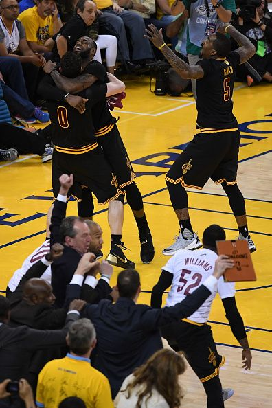 LeBron James Kevin Love and JR Smith of the Cleveland Cavaliers celebrate  after defeating the Golden State Warriors 9389 in Game 7 of the 2016 NBA. ba7bfab4e