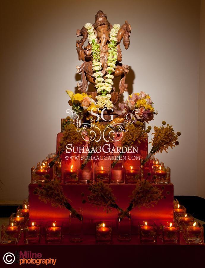 wooden Ganesh statue floral garland event decor